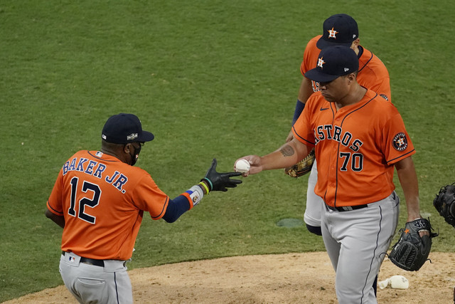 Houston-Astros-pitcher-Andre-Scrubb-70-is-relieved-by-Houston-Astros-manager-Dusty-Baker-Jr-during-t