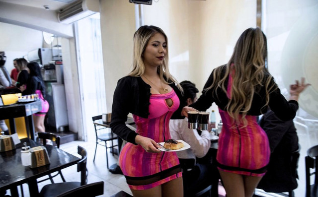 Waitresses-are-seen-at-a-Cafe-con-Piernas-Coffee-with-Legs-coffee-shop-in-downtown-Santiago-on-Septe