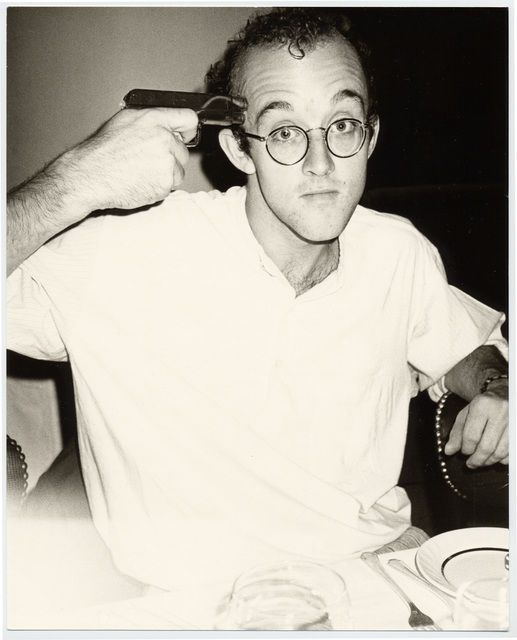 Keith-Haring-with-a-gun-taken-by-warhol.jpg