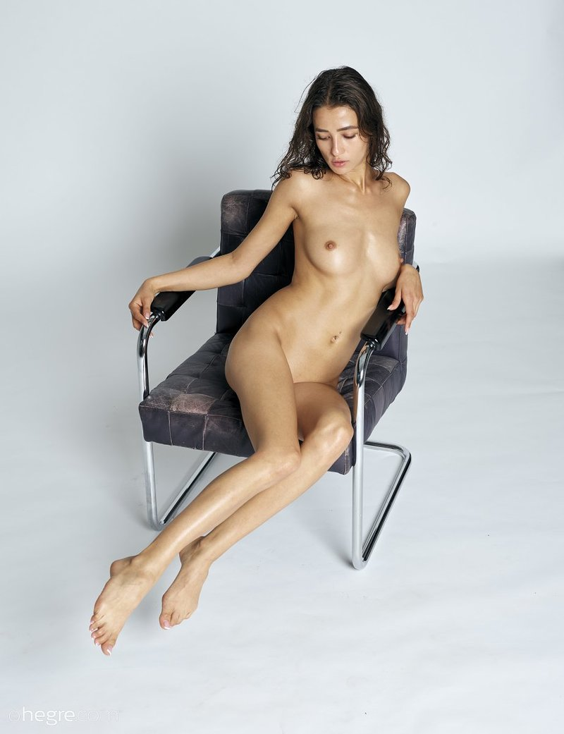 stunning-brunette-hottie-presents-her-perfect-body-on-the-armchair-01-w800