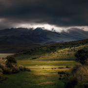 photography-of-mountains-under-cloudy-sky-1183099
