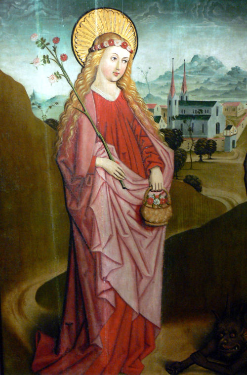 An image of St Dorothea, crowned by roses.