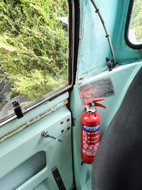 Given the degree of concern raised regarding the old Halon one from the car I have swapped it out for a standard powder one.    I will probably move this at some point as I'm not keen on this location.  It's a real shame that they just drilled holes in to vehicle build plate when they fitted the original extinguisher.