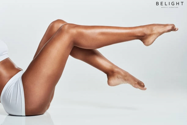 Cropped-shot-of-a-young-woman-s-legs-against-a-grey-background