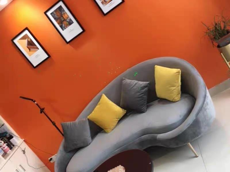 Slender modern curved sofa
