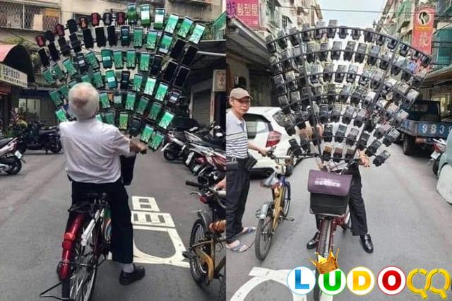 Seorang Kakek di Tiongkok Mainkan Pokemon Go dengan 64 Smartphone