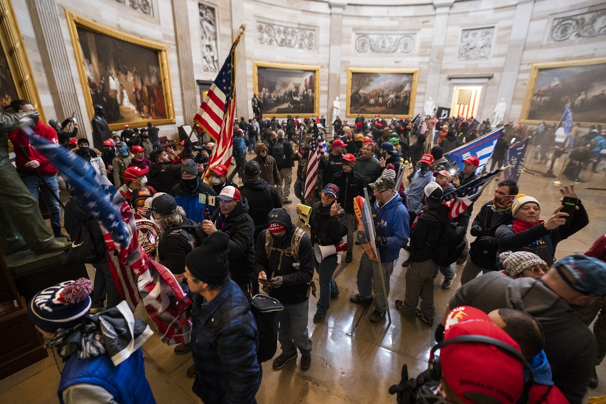 epa08923423-Supporters-of-US-President-Donald-J-Trump-in-the-Capitol-Rotunda-after-breaching-Capitol