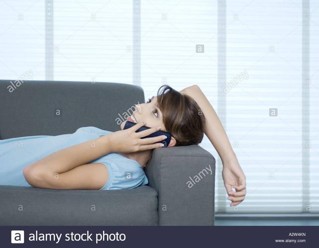 [Image: woman-lying-on-sofa-talking-on-phone-A2-W4-KN-1.jpg]
