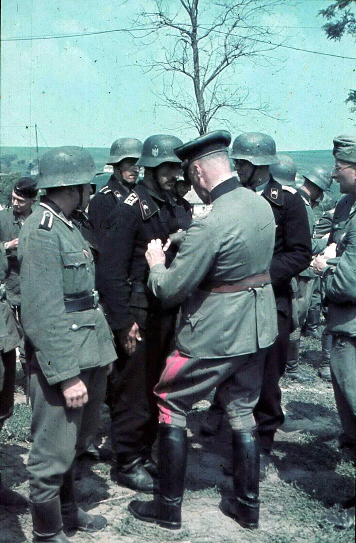 Rewarding Wehrmacht soldier 1941. Major General Ludwig Cruewell. Photo in color