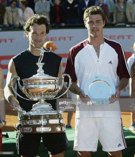 BARCELONA-SPAIN-APRIL-27-Carlos-Moya-L-of-Spain-poses-with-the-trophy-after-winning-the-Seat-Open-Me