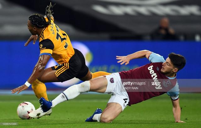 Wolverhampton-Wanderers-Spanish-midfielder-Adama-Traore-L-is-tackled-by-West-Ham-United-s-English-mi
