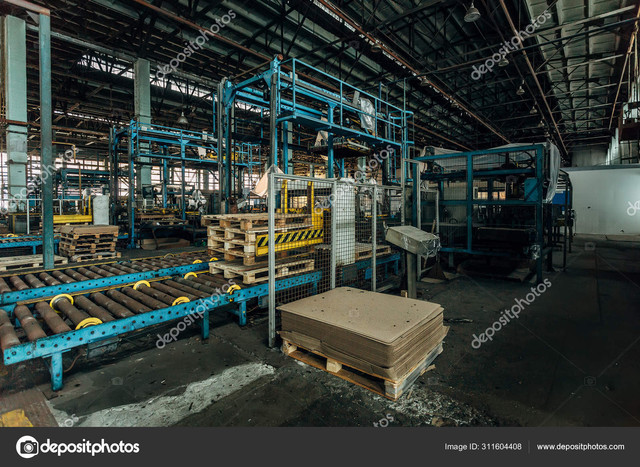 https://i.ibb.co/vYNKTzv/Old-roller-conveyor-and-packing-machine-in-abandoned-factory.jpg