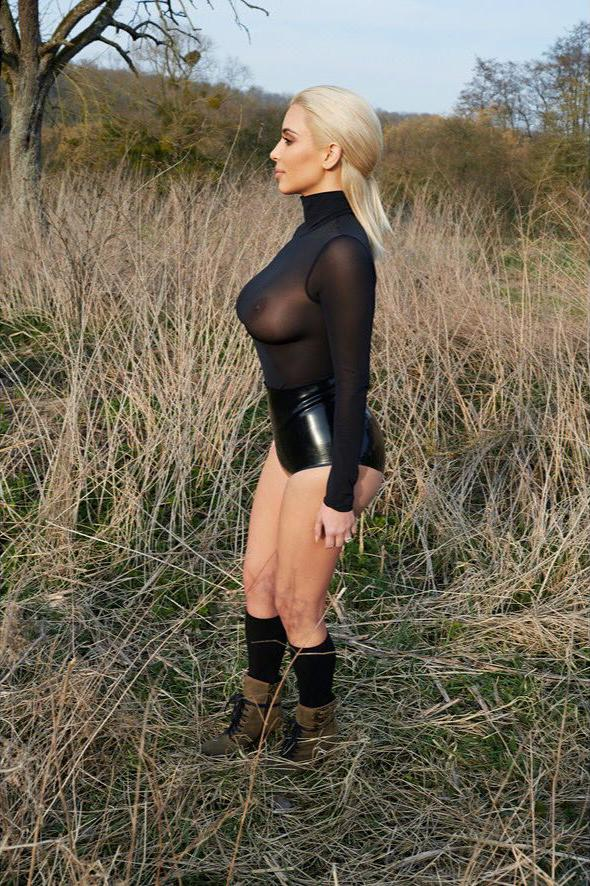 Kim-Kardashian-with-blonde-hair-in-a-see-through-top-modeling-side-view