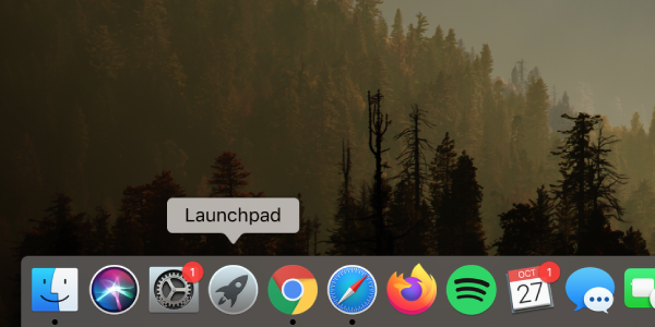 """Grey circle with rocket ship """"Launchpad"""" icon in Mac dock at bottom of screen highlighted"""
