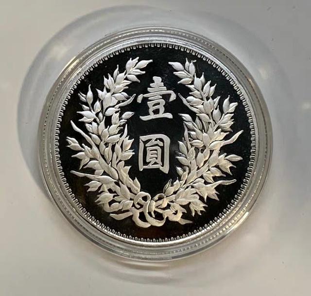 restrike-big-head-coin