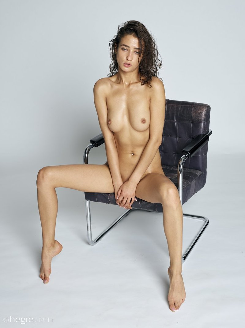stunning-brunette-hottie-presents-her-perfect-body-on-the-armchair-10-w800