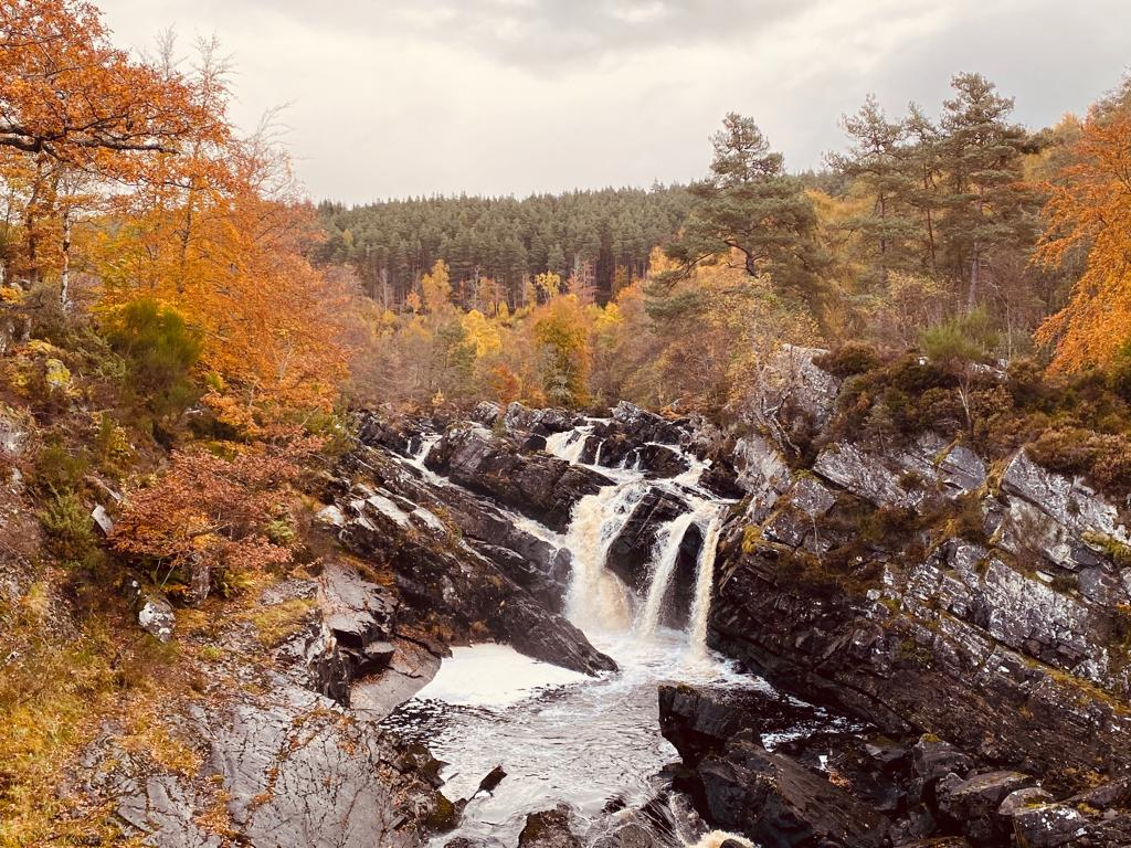 Waterfall and rocks, trees with Autumn leaves, Scottish Vacation