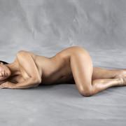 Kim-Kardashian-laying-on-her-side-modeling-nude