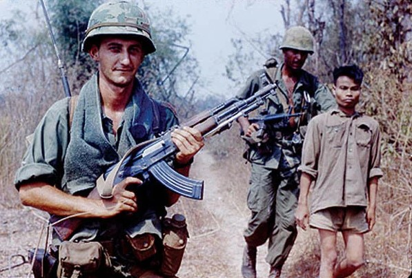 American soldier with an Ak 47 assault rifle in Vietnam