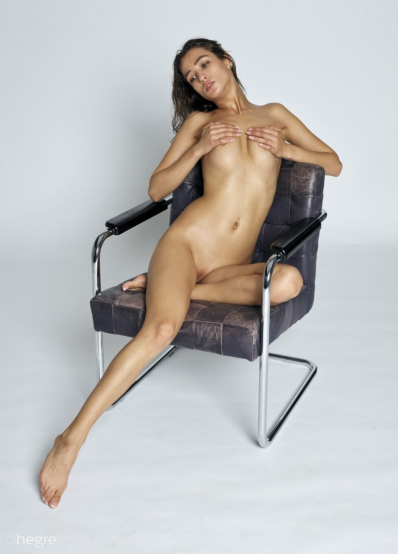 stunning-brunette-hottie-presents-her-perfect-body-on-the-armchair-07-w800