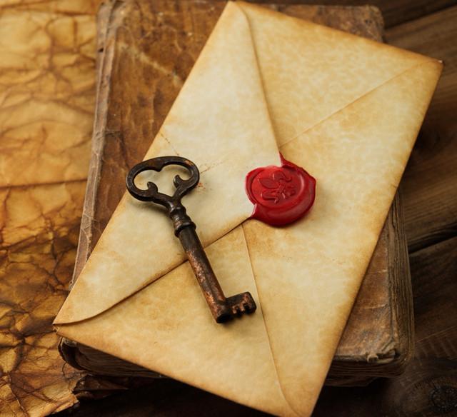 Book old key and envelope on vintage blank paper