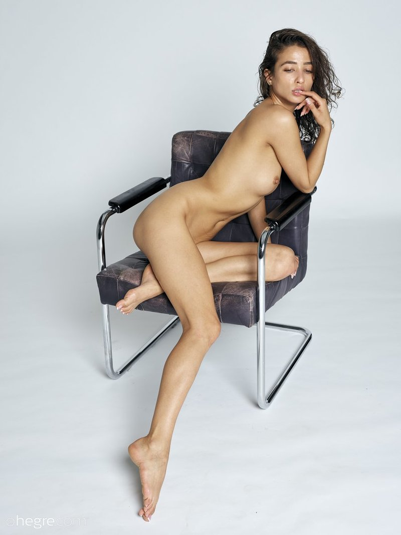 stunning-brunette-hottie-presents-her-perfect-body-on-the-armchair-08-w800