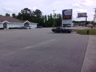 https://i.ibb.co/yN5yt36/Bash-Church-parking-lot.jpg