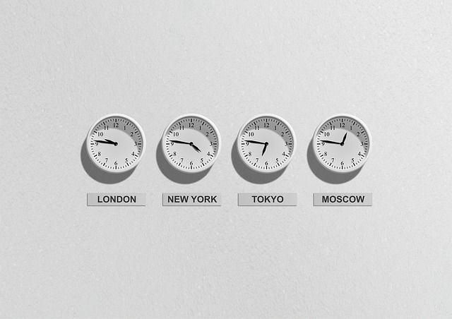 An image of four clocks on a wall showing the time in London, New York, Tokyo and Moscow.