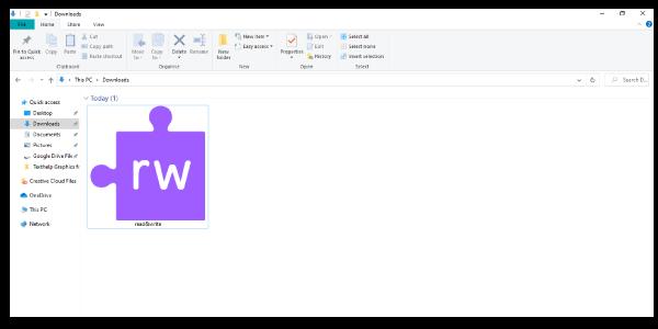 Purple Read&Write jigsaw piece icon as a .zip file in a Windows downloads folder