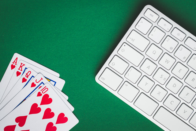 Concept-of-on-line-poker-game-Poker-cards-and-keyboard
