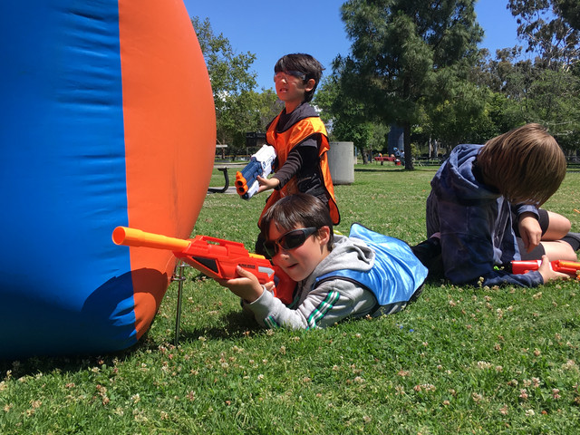 Child aiming his Nerf Alpha Rogue Blaster during Nerf Gun Party on May 19 in Santa Monica