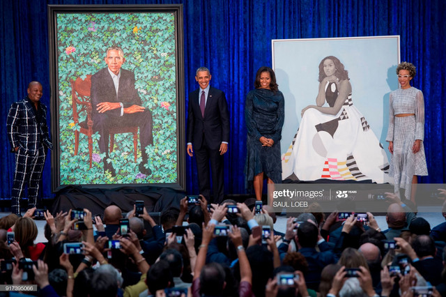 TOPSHOT-Former-US-President-Barack-Obama-and-First-Lady-Michelle-Obama-stand-before-their-portraits-.jpg