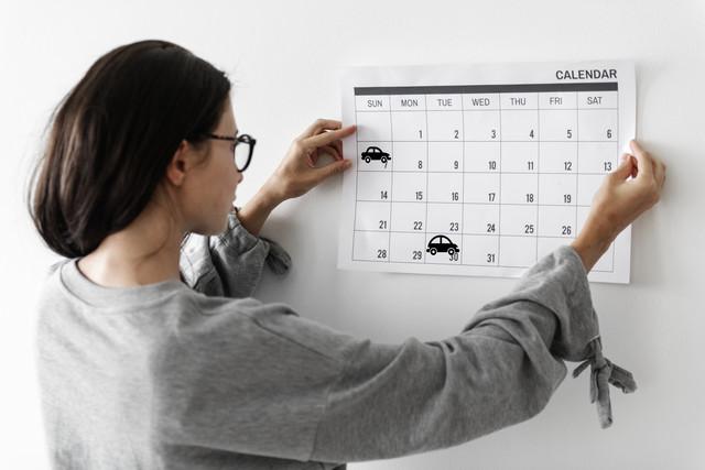 Woman-checking-the-calendar