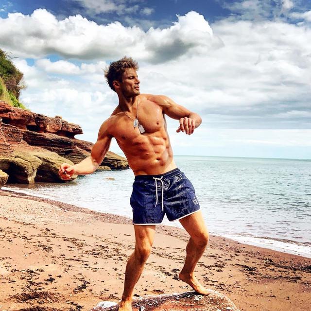 Bradley-shirtless-on-beach
