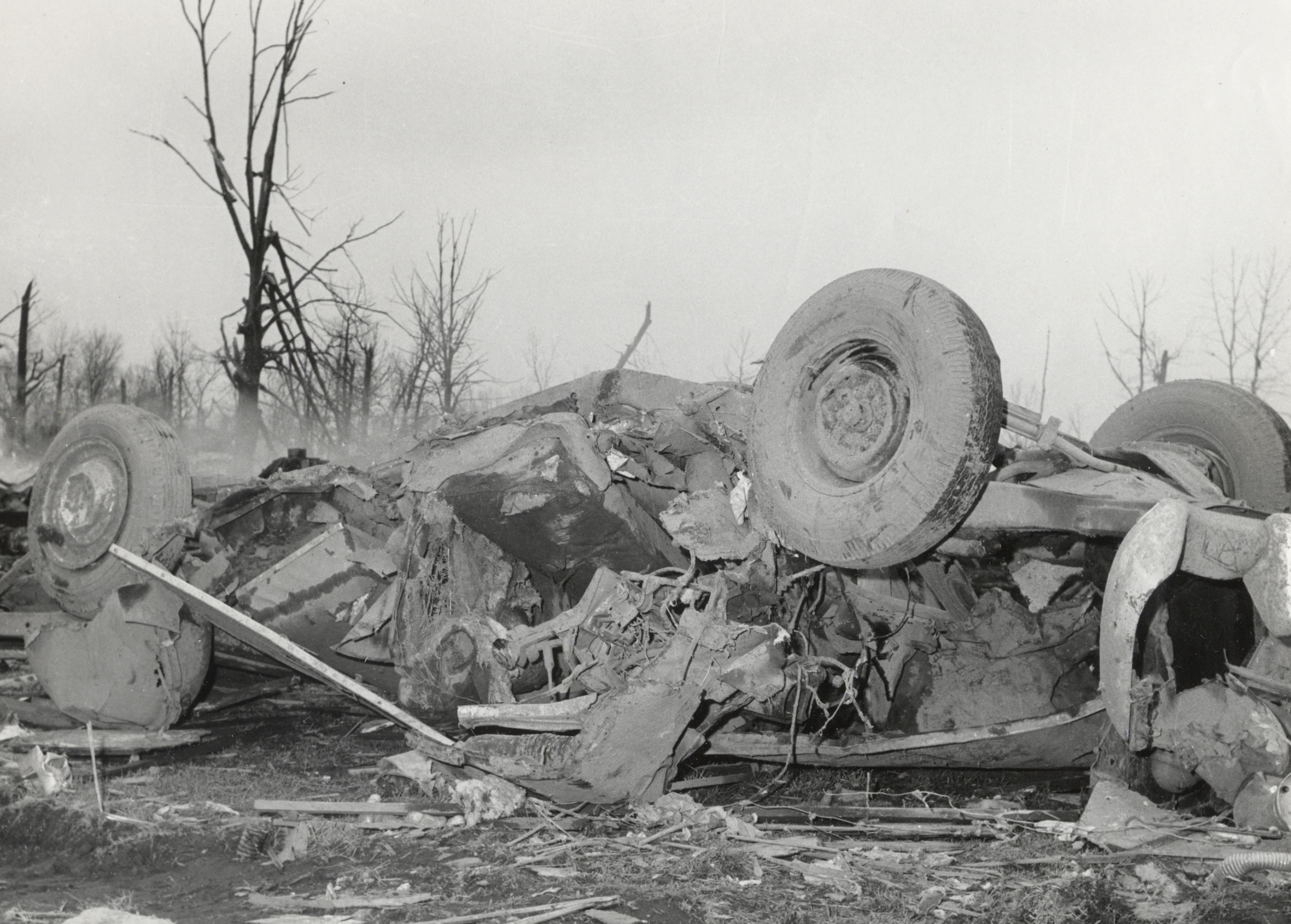 A-vehicle-is-shown-destroyed-after-the-1965-Palm-Sunday-tornadoes-At-least-49-people-died.jpg